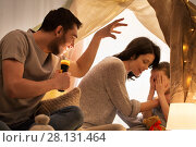 Купить «father telling scary stories to his daughter», фото № 28131464, снято 27 января 2018 г. (c) Syda Productions / Фотобанк Лори
