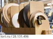Купить «veneer or edge band tapes at woodworking factory», фото № 28131496, снято 10 ноября 2017 г. (c) Syda Productions / Фотобанк Лори