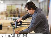 Купить «assembler with screwdriver making furniture», фото № 28131508, снято 10 ноября 2017 г. (c) Syda Productions / Фотобанк Лори