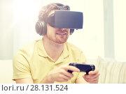 Купить «man in virtual reality headset with controller», фото № 28131524, снято 12 марта 2016 г. (c) Syda Productions / Фотобанк Лори