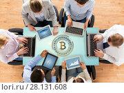 Купить «business team with computers and bitcoin hologram», фото № 28131608, снято 10 октября 2014 г. (c) Syda Productions / Фотобанк Лори