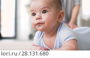 Купить «sweet little asian baby boy with mother», видеоролик № 28131680, снято 24 февраля 2018 г. (c) Syda Productions / Фотобанк Лори