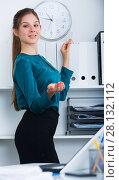 Купить «Female entrepreneur looking for documents on shelves», фото № 28132112, снято 31 июля 2017 г. (c) Яков Филимонов / Фотобанк Лори