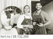 Купить «Woman makeup artist and man hairdresser in the salon», фото № 28132200, снято 23 сентября 2018 г. (c) Яков Филимонов / Фотобанк Лори
