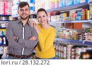 Купить «Couple standing among shelves with groceries», фото № 28132272, снято 20 января 2018 г. (c) Яков Филимонов / Фотобанк Лори