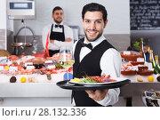 Купить «Waiter with serving tray in fish restaurant», фото № 28132336, снято 26 января 2018 г. (c) Яков Филимонов / Фотобанк Лори
