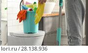 Купить «Woman holding mop and bucket with cleaning at home», видеоролик № 28138936, снято 7 марта 2018 г. (c) Ekaterina Demidova / Фотобанк Лори