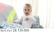 Купить «Baby boy sitting and reading a book», видеоролик № 28139000, снято 7 марта 2018 г. (c) Ekaterina Demidova / Фотобанк Лори