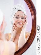 Купить «Woman having a look at her face at the mirror», фото № 28139428, снято 5 июля 2020 г. (c) Яков Филимонов / Фотобанк Лори