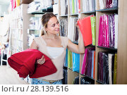 Купить «Woman shopping tablecloths in home textile store», фото № 28139516, снято 16 октября 2018 г. (c) Яков Филимонов / Фотобанк Лори