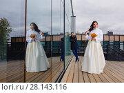 Beautiful couple newlyweds near the mirror wall. Стоковое фото, фотограф Чебеляев Геннадий / Фотобанк Лори