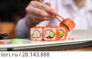 teenager eats rolls in restaurant. Стоковое видео, видеограф Володина Ольга / Фотобанк Лори