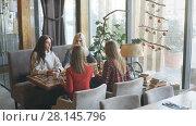 Купить «Four female friends enjoying in talking at cafe», видеоролик № 28145796, снято 30 января 2018 г. (c) Виктор Аллин / Фотобанк Лори
