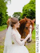 Купить «Beautiful young bride with the horse», фото № 28145952, снято 22 июля 2017 г. (c) Чебеляев Геннадий / Фотобанк Лори