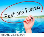 Купить «Man Hand writing Fast and Furious with black marker on visual screen», фото № 28149924, снято 13 декабря 2018 г. (c) easy Fotostock / Фотобанк Лори