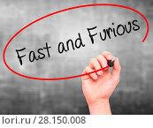 Купить «Man Hand writing Fast and Furious with black marker on visual screen», фото № 28150008, снято 13 декабря 2018 г. (c) easy Fotostock / Фотобанк Лори