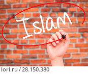 Купить «Man Hand writing Islam with black marker on visual screen», фото № 28150380, снято 22 июля 2018 г. (c) easy Fotostock / Фотобанк Лори