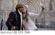Купить «Adult tourists taking selfie on mobile phone at historical street», видеоролик № 28151104, снято 27 ноября 2017 г. (c) Яков Филимонов / Фотобанк Лори