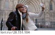 Купить «Adult tourists taking selfie on mobile phone at historical street», видеоролик № 28151104, снято 27 ноября 2017 г. (c) Яков Филимонов / Фотобанк Лори