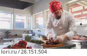 Купить «Chef serves the salad by placing the ingredients on a plate», фото № 28151504, снято 20 апреля 2018 г. (c) Константин Шишкин / Фотобанк Лори