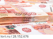 Купить «Stack of five thousandths banknotes of russian roubles close up», фото № 28152676, снято 9 января 2017 г. (c) FotograFF / Фотобанк Лори