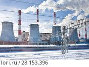 Купить «Дымящие трубы теплоэлектростанции в городе», фото № 28153396, снято 9 марта 2018 г. (c) Victoria Demidova / Фотобанк Лори