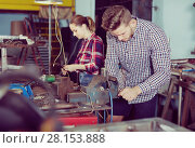 Купить «man is working near vise», фото № 28153888, снято 10 октября 2017 г. (c) Яков Филимонов / Фотобанк Лори