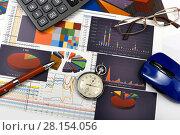 Купить «Калькулятор, таблицы, графики и диаграммы. Бизнес-натюрморт», эксклюзивное фото № 28154056, снято 11 марта 2018 г. (c) Юрий Морозов / Фотобанк Лори