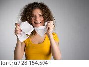 Купить «woman furiously tore the paper», фото № 28154504, снято 29 января 2018 г. (c) Типляшина Евгения / Фотобанк Лори