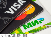 Купить «Пластиковые карточки платежных систем VISA, MasterCard, МИР, крупным планом», фото № 28154888, снято 12 марта 2018 г. (c) Алексей Букреев / Фотобанк Лори