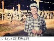 Купить «Smiling woman is holding glass of milk», фото № 28156288, снято 24 октября 2017 г. (c) Яков Филимонов / Фотобанк Лори