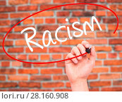 Купить «Man Hand writing Racism with black marker on visual screen.», фото № 28160908, снято 21 июля 2018 г. (c) easy Fotostock / Фотобанк Лори