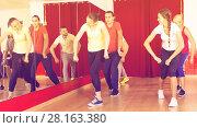Купить «Energetic people on choreography lesson», фото № 28163380, снято 19 января 2020 г. (c) Яков Филимонов / Фотобанк Лори