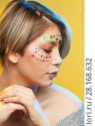 Купить «young woman with holiday makeup on her face», фото № 28168632, снято 12 декабря 2017 г. (c) Владимир Мельников / Фотобанк Лори