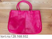 Купить «pink stylish female bag on the wooden floor top view», фото № 28168932, снято 17 июля 2016 г. (c) Константин Лабунский / Фотобанк Лори