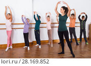 Купить «Young ballet dancers exercising in ballroom», фото № 28169852, снято 12 ноября 2016 г. (c) Яков Филимонов / Фотобанк Лори