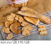 Купить «Various kinds of bread and bakery products on table», фото № 28170128, снято 30 января 2018 г. (c) Яков Филимонов / Фотобанк Лори