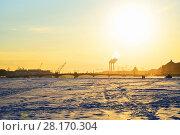 Купить «View of the Annunciation bridge from the ice of the Neva river at sunset», фото № 28170304, снято 7 марта 2018 г. (c) Максим Мицун / Фотобанк Лори