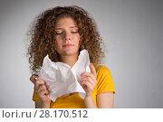 Купить «woman furiously tore the paper», фото № 28170512, снято 29 января 2018 г. (c) Типляшина Евгения / Фотобанк Лори