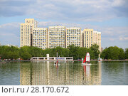 Купить «MOSCOW - MAY 08, 2016: Racing yacht in front of residential complex at Ostankino pond», фото № 28170672, снято 8 мая 2016 г. (c) Losevsky Pavel / Фотобанк Лори