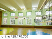 Купить «MOSCOW, RUSSIA - JUN 28, 2016: Gym with basketball hoops, volleyball net in 2107 school, In Moscow there are more than 1800 schools», фото № 28170700, снято 28 июня 2016 г. (c) Losevsky Pavel / Фотобанк Лори