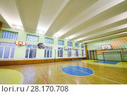 Купить «MOSCOW, RUSSIA - JUN 28, 2016: Gym with volleyball net, basketball hoops in 2107 school, In Moscow there are more than 1800 schools», фото № 28170708, снято 28 июня 2016 г. (c) Losevsky Pavel / Фотобанк Лори