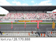 Купить «MOSCOW - SEP 3, 2016: Track and grandstands at Race of Stars At wheel Magazine at Moscow Raceway», фото № 28170888, снято 3 сентября 2016 г. (c) Losevsky Pavel / Фотобанк Лори