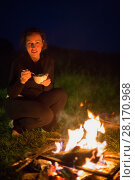 Купить «Woman with plate near warm fire at night at nature during walking-tour», фото № 28170968, снято 1 июля 2016 г. (c) Losevsky Pavel / Фотобанк Лори