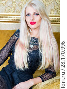 Купить «Beautiful blonde in black lace dress poses on couch with yellow upholstery in room», фото № 28170996, снято 20 ноября 2015 г. (c) Losevsky Pavel / Фотобанк Лори