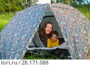 Купить «Happy woman and her little son are in tent outdoor at summer day», фото № 28171088, снято 2 июля 2016 г. (c) Losevsky Pavel / Фотобанк Лори