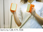 Купить «Doctor puts electroshock probes close together in hospital cabinet, noface», фото № 28171104, снято 20 ноября 2015 г. (c) Losevsky Pavel / Фотобанк Лори