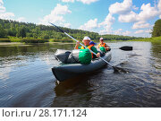 Купить «Two women and little boy sail on inflatable boats on river at sunny summer day», фото № 28171124, снято 3 июля 2016 г. (c) Losevsky Pavel / Фотобанк Лори