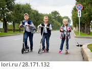 Купить «Two boys and girl stand with push scooters on road», фото № 28171132, снято 10 сентября 2016 г. (c) Losevsky Pavel / Фотобанк Лори