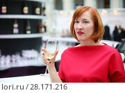 Купить «Middle age woman in red dress drinks wine during event, shallow dof», фото № 28171216, снято 25 марта 2016 г. (c) Losevsky Pavel / Фотобанк Лори